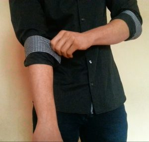 How to roll up your shirt sleeves - master roll step 2